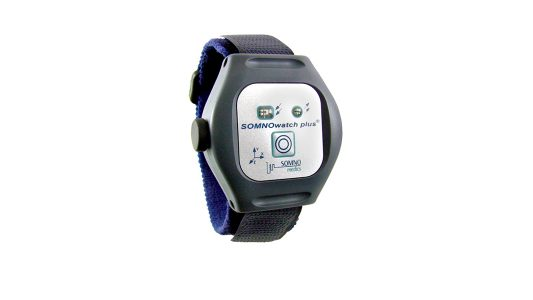 A picture of the SOMNOwatch Plus wearable datalogger and strap.