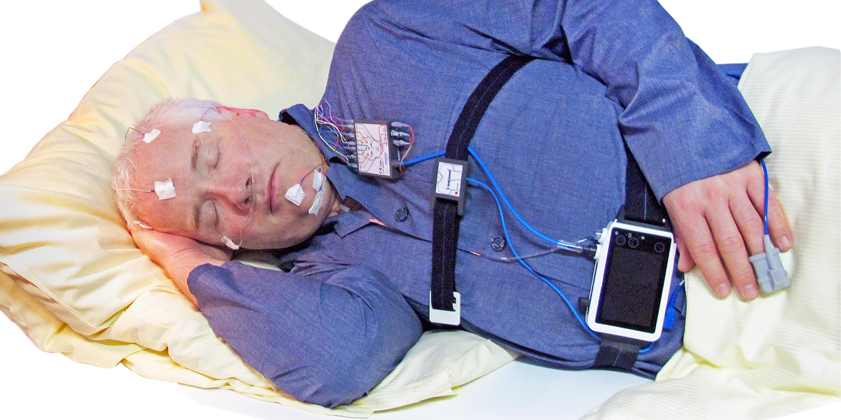 A patient wearing a SOMNO HD PSG device - highlighting how small and mobile it is.