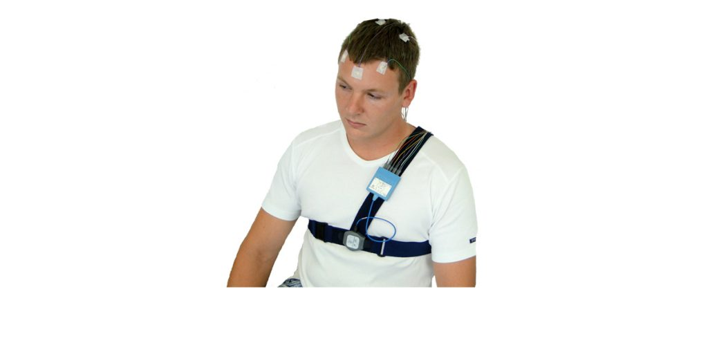 A patient wearing a SOMNOwatch and headbox.