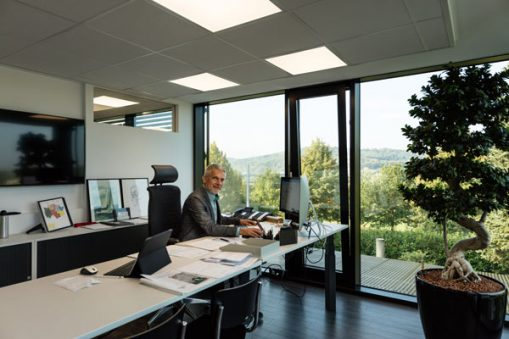 Dr Küchler the owner and CEO of SOMNOmedics GmbH sits at his desk